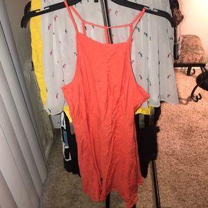 Bright orange flirty dress.